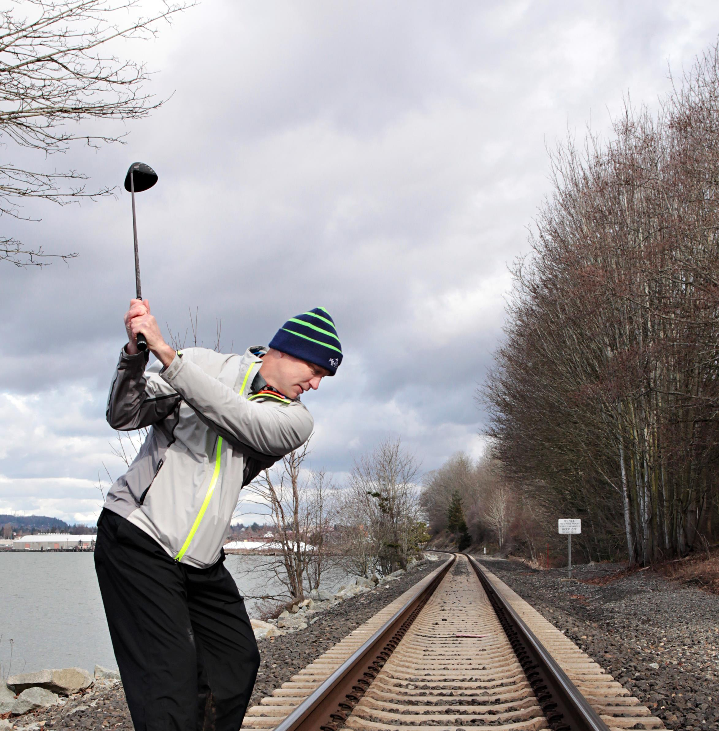 Brian Weeda golfing on the train tracks