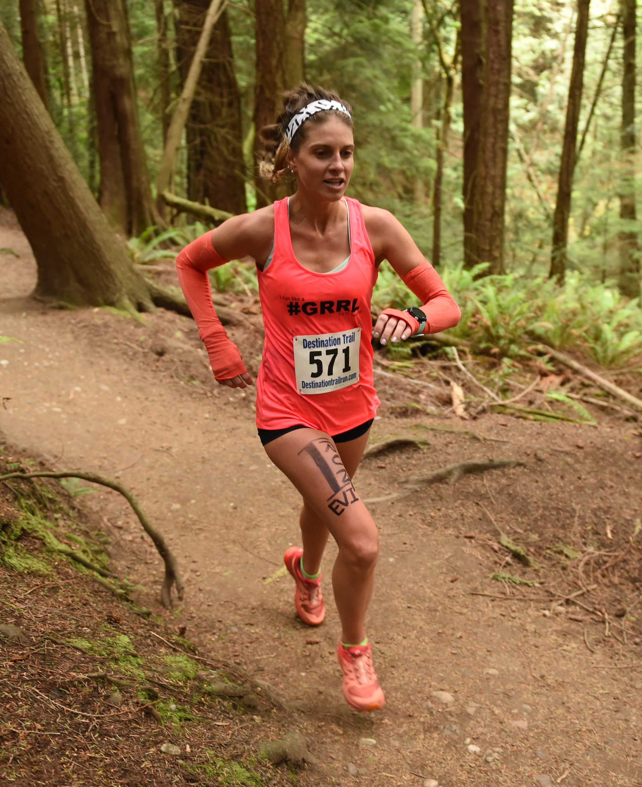 Alicia Jenkins running in a forest