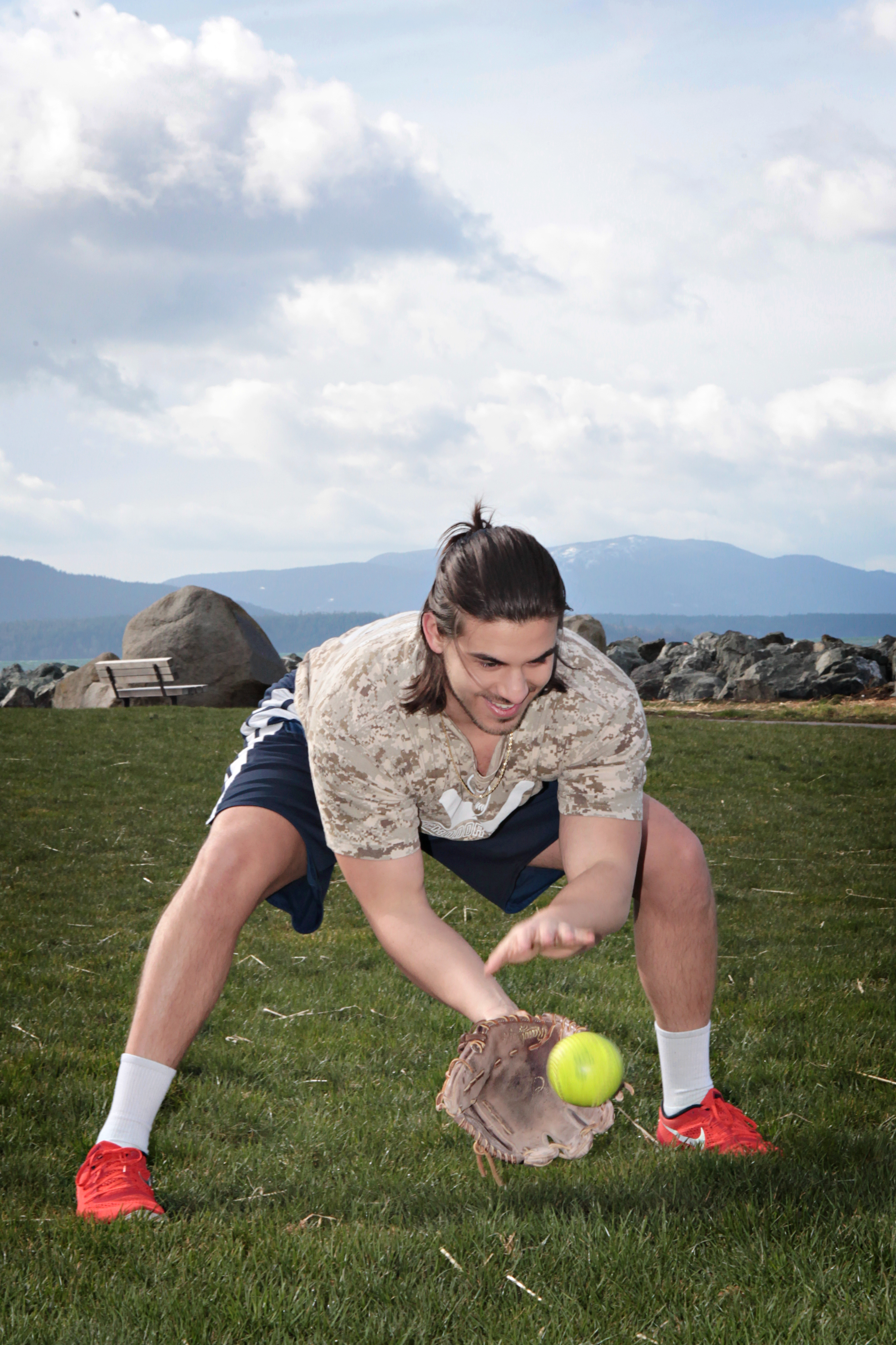 Conner Eddy catching a tennis ball in a baseball mitt