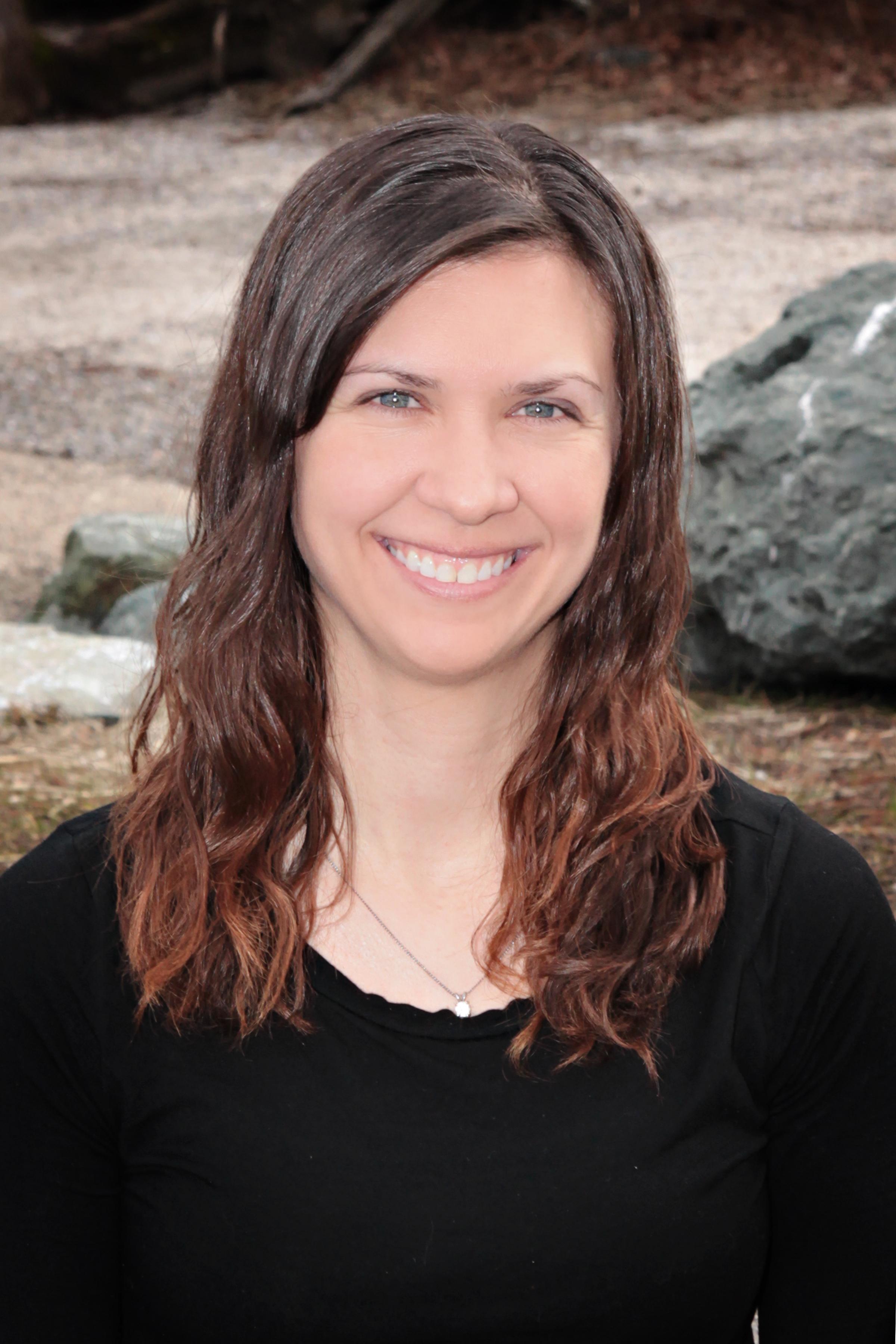 Katrina Schwerdtfeger at the beach wearing a black shirt