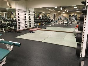 Weight room showing a mirror on one wall