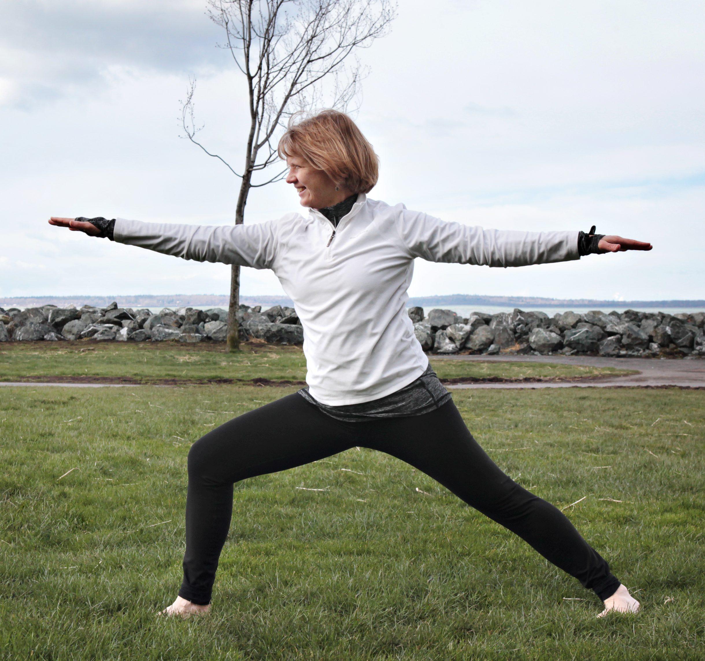 Brenda Henoch stretching on the grass
