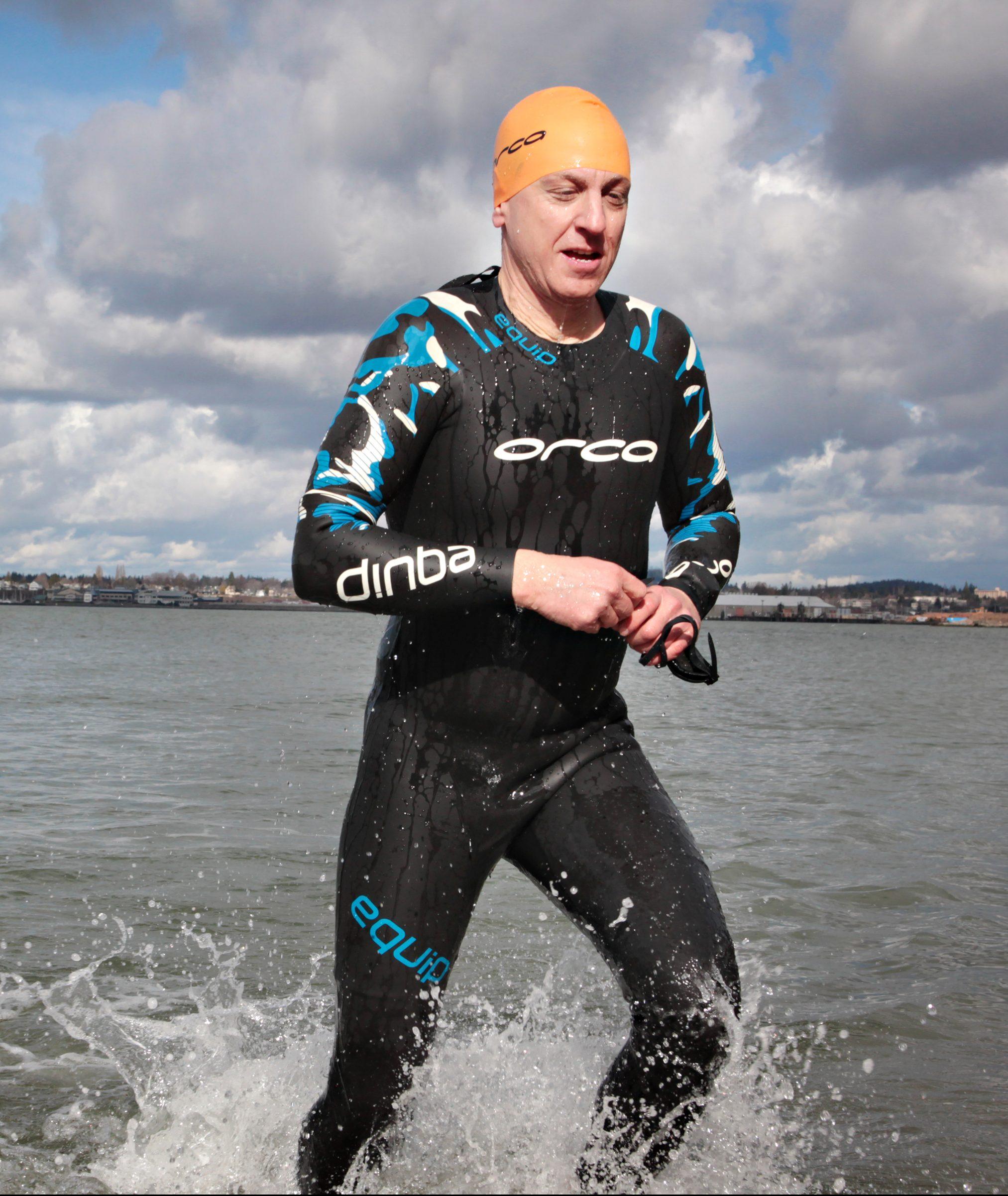 Trevor LeDain in the water in a wetsuit